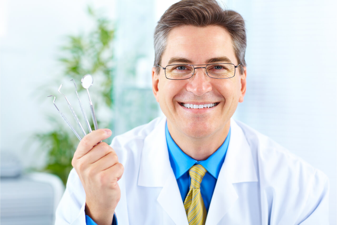 dentist with dental tools