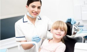 child under tooth extaction process