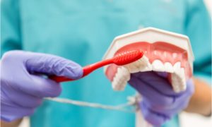 how to brush dentures
